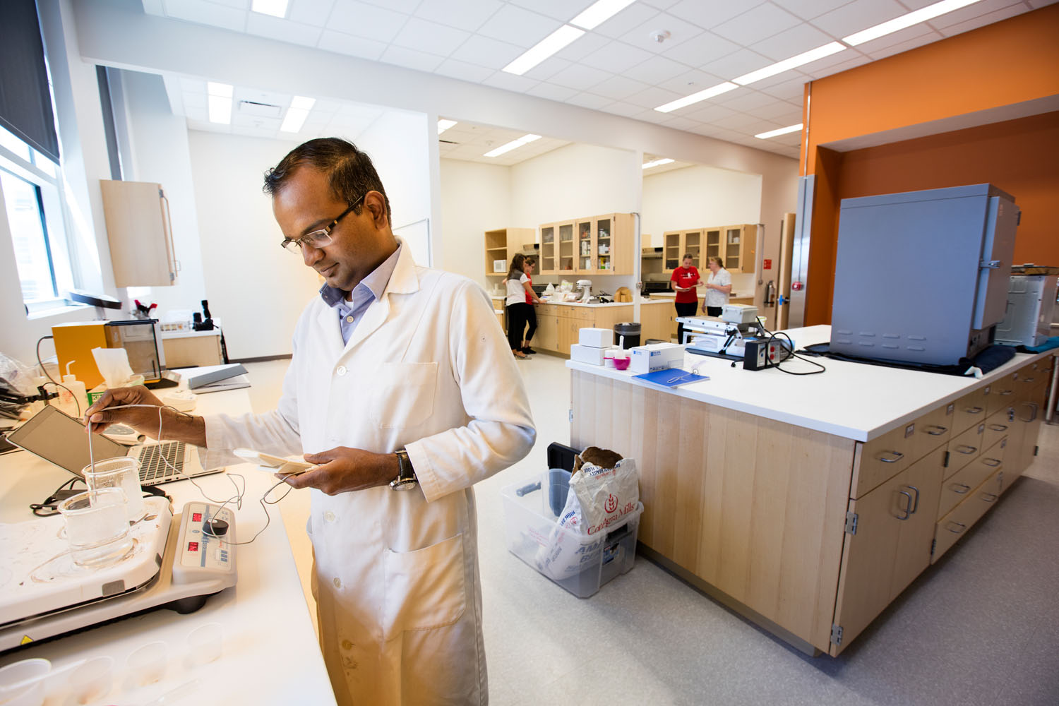 Postdoc Krishnamoorthy Pitchai conducting research in a Food Innovation Center lab.