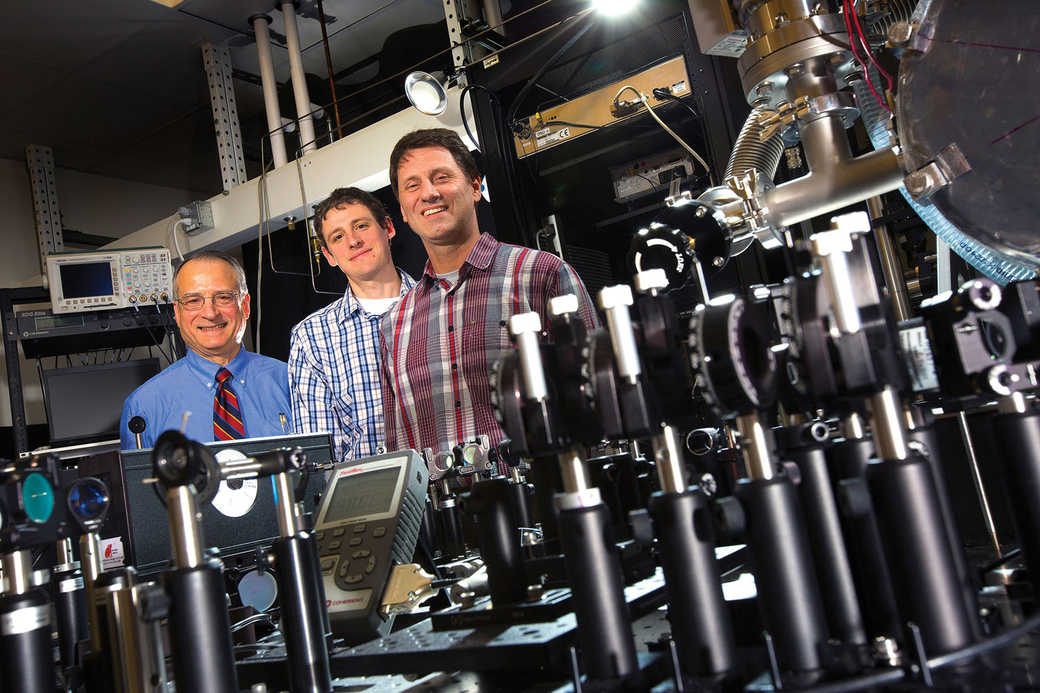 Anthony Starace, Martin Centurion and Herman Batelaan lead UNL's consortium participation collaborating with colleagues at Kansas State University and the University of Kansas on the Nebraska-Kansas Consortium. The partnership seeks to expand all three universities' capacity to study atomic, molecular and optical physics. February 11, 2015. Photo by Craig Chandler / University Communications.