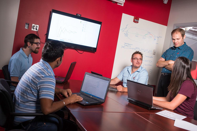 Tomas Helikar and Joe Dauer (center) with postdocs Heather Bergan-Roller, Bhanwar Lal Puniya and student worker Greyson Biegert