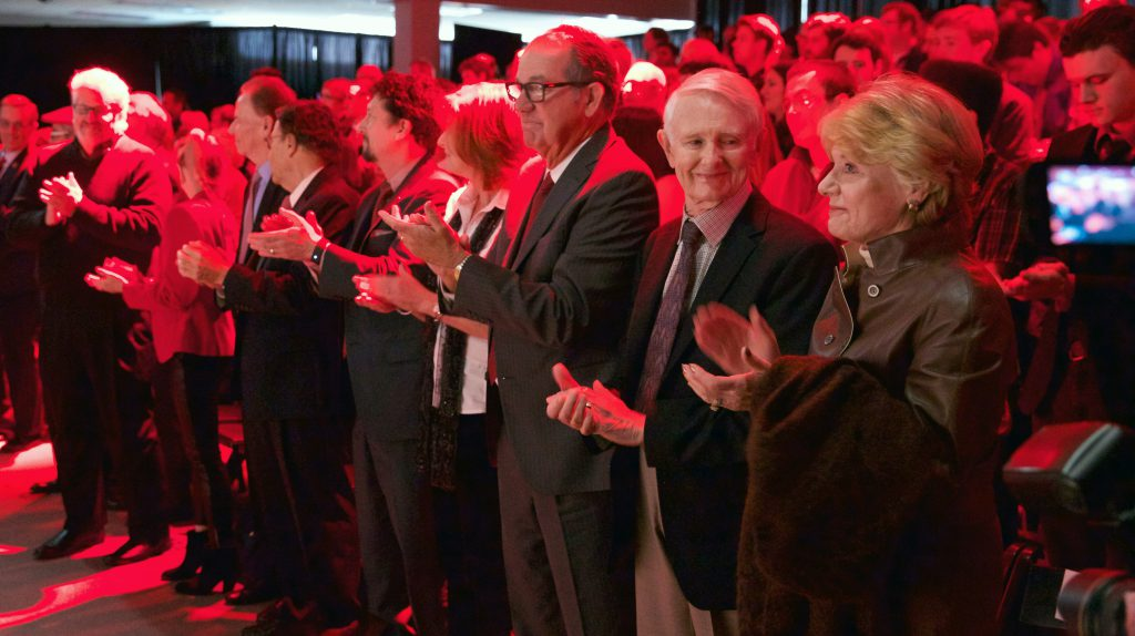 Members of Johnny Carson's family and the Carson Foundation applaud as the song There is No Place Like Nebraska is played during the Nov. 6 gift announcement. Pictured (from right) is Karlyn Carson, Dick Carson, Jeff Sotzing, Peggy Sotzing, Larry Witzer, Allan Alexander and Larry Heller.