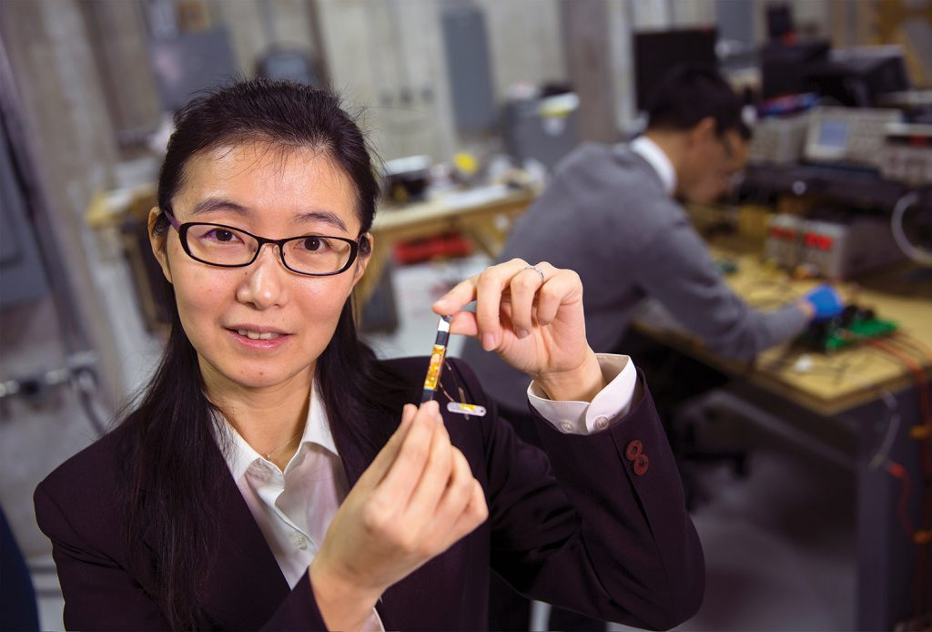 Liyan Qu holds a prototype of a device that could help revolutionize the power grid. Qu is UNL's newest NSF CAREER award. February 12, 2016. Photo by Craig Chandler / University Communications