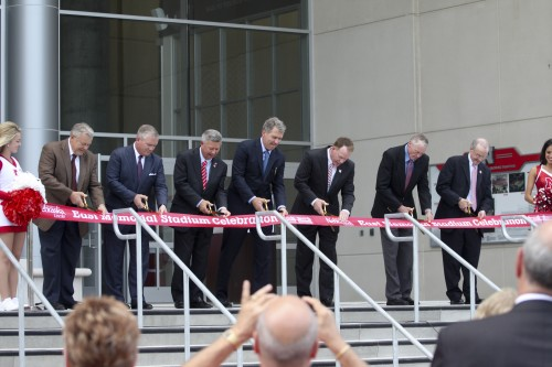 Officials cut ribbon in front of the East Memorial Stadium expansion.